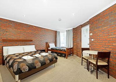 Beds MOTEL FAMILY ROOM at Golden Country Motel Maryborough